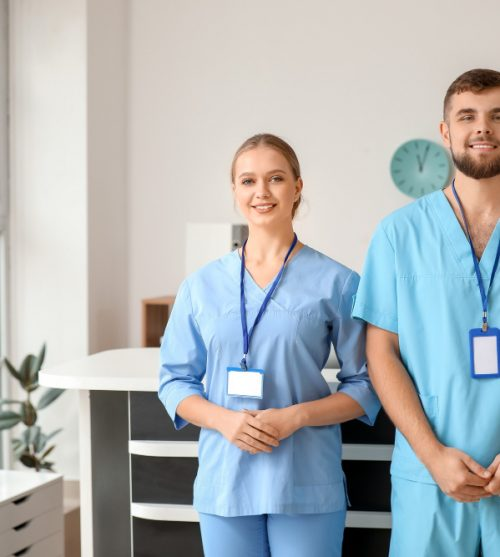 male-and-female-receptionists-in-clinic