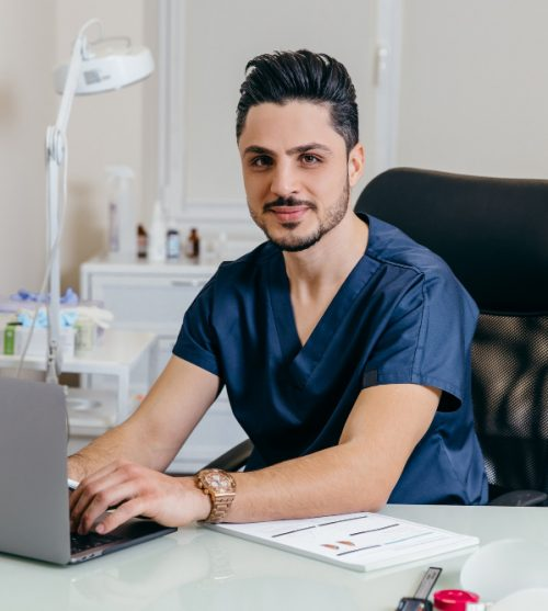 young-arabic-or-turkish-doctor-in-blue-uniform-conducts-online-counseling